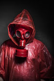 Man with red gas mask — Stock Photo