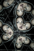 Woman in a kaleidoscope of mirrors — Stock Photo