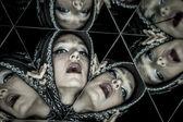 Woman in a kaleidoscope of mirrors — Zdjęcie stockowe