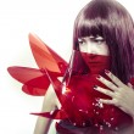 Sensual woman in red armor — Stock Photo #58375695