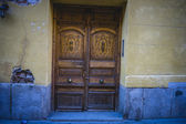 Old wooden door with carvings — Stock Photo