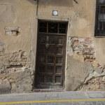 Street, medieval door Spanish city of Segovia. — Stock Photo #69530147