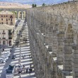Tourist, Roman aqueduct of segovia. — Stock Photo #69530557