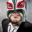 Businessman with Mexican wrestler mask — Stock Photo #70152745