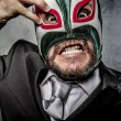 Businessman with Mexican wrestler mask — Stock Photo #70152761