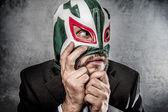 Stress, businessman angry with Mexican wrestler mask — Stock Photo