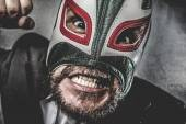 Businessman angry with Mexican wrestler mask — Stockfoto