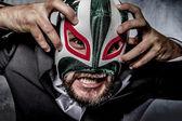 Businessman with Mexican wrestler mask — Stok fotoğraf