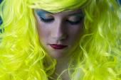 Sad, young girl with yellow hair — Stock Photo