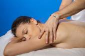 Masseur doing massage on woman — Stock Photo