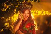 Girl in red dress and russian traditional headdress — Stock Photo