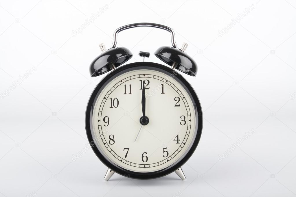 Twelve o'clock. Alarm clock. � Foto stock � grassyone #69498107