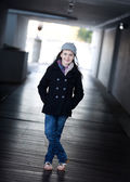 Girl or model in alleyway wearing winter clothing, she is relaxe — Stock Photo