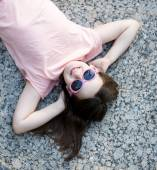 Tween young girl lying on grass using call phone — Stock Photo