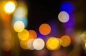 Defocused urban abstract texture, bokeh lights of city lights in the background with blurring lights — Stock Photo