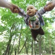 Dad playing with son  in park — Stock Photo #54424565