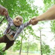 Dad playing with son  in park — Stock Photo #54424575