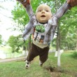 Dad playing with son  in park — Stock Photo #54424579