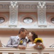 Bride and groom standing near beautiful mansion — Stock Photo #54424665