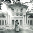 Bride and groom standing near beautiful mansion — Stock Photo #54424681