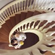 Bride and groom standing near stairs — Stock Photo #54424831