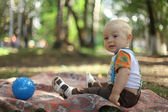 Child playing with ball in park — Stock Photo
