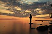 Man on the lake on sunset — Stock Photo