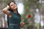 Woman with rose flower — Stock Photo