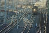 Railroad rails with train — Stok fotoğraf