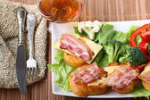Breakfast toast with bacon and herbs — Stock Photo
