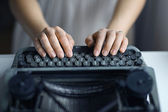 Hands typing on old typing machine — Stok fotoğraf