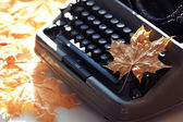Typewriter  with autumn leaf — Stock Photo