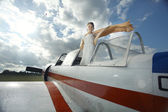 Girl in small plane — Stock Photo