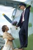 Couple at old airplane — Stock Photo