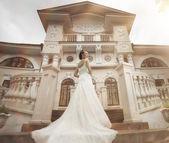 Bride near castle — Stock Photo