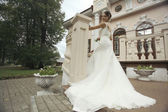 Bride near castle — Stock Photo