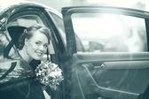 Bride in car — Stock Photo