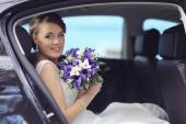Bride in car — Stock Photo