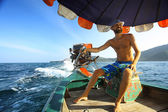Tanned man on boat — Stock Photo