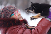 Girl and puppy in winter — Stock fotografie