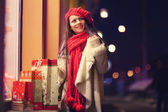 Girl on Christmas discounts shopping — Stock Photo