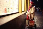 Girl on Christmas discounts shopping — Stock Photo