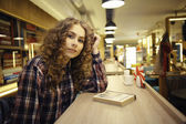 Young girl in library — Stock Photo