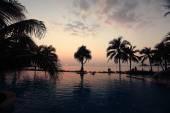 Pool at sea sunset beach — Stock Photo