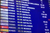 Flights departures schedules at airport — Fotografia Stock