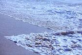 Sea surf wave on beach — Stock Photo