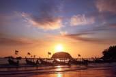 Boats at sunset beach — Stock Photo