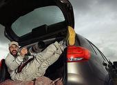 Photographer traveler in car — Stock Photo
