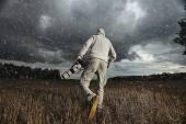 Photographer in autumn field — Stock Photo