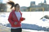 Young sporty girl running — Zdjęcie stockowe